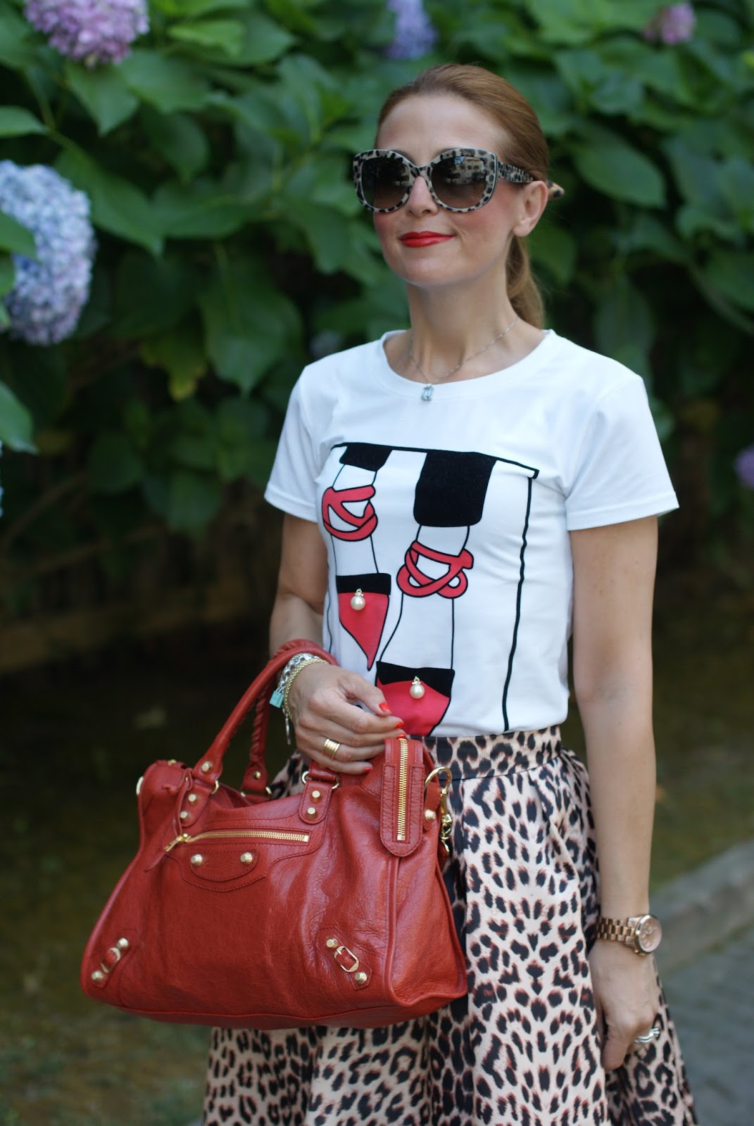 Leopard print is the new neutral with Balenciaga City, Dolce & Gabbana sunglasses found on Giarre.com, leopard print midi skirt on Fashion and Cookies fashion blog, fashion blogger style