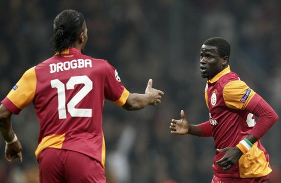 Emmanuel Eboué celebrates with teammate Didier Drogba after scoring against Real Madrid