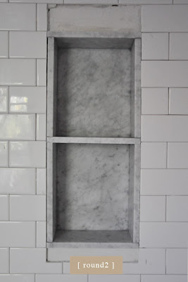 traditional bathroom. marble shower niche.