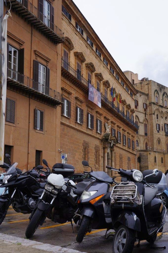 Motorcycles parked at the Palazzo Reale o dei Normanni in Palermo Sicility Italy.