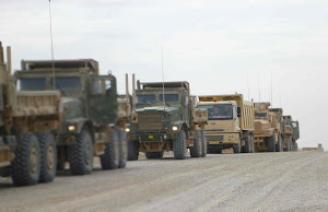 DUMP TRUCKS IN AFGHANISTAN WORKING TO BUILD ROADS