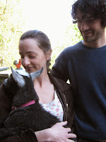 Couple holds black and white Nigerian Dwarf Goat