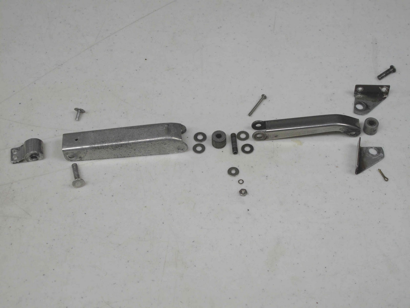Here are the parts disassembled. The key parts are (L - R) the extruded aluminum bracket which is riveted to the window frame & Cessna 140 Rebirth: Window Latch Parts (Cessna 0411186)