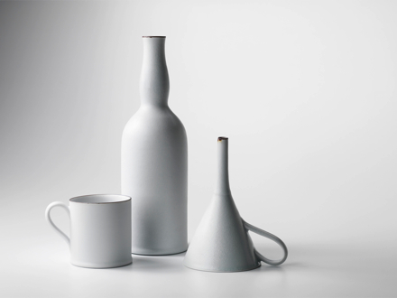 white porcelain bottle, beaker and hopper