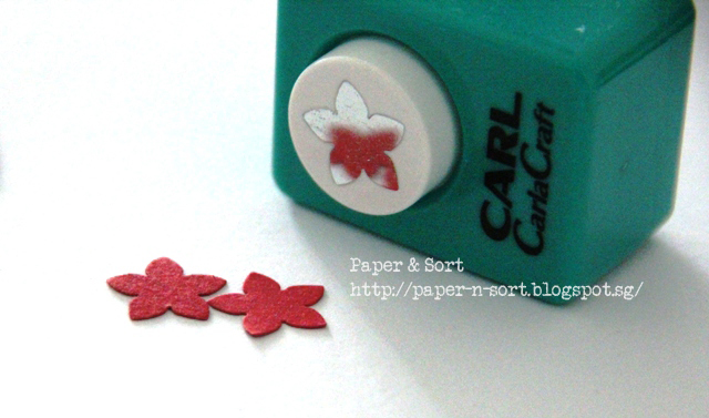 upcycle project - poinsettia flower punch made of paper scrap