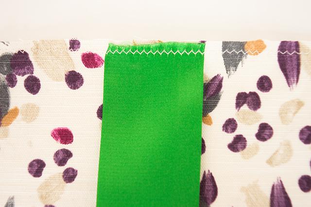 ribbon handles sewn to bag