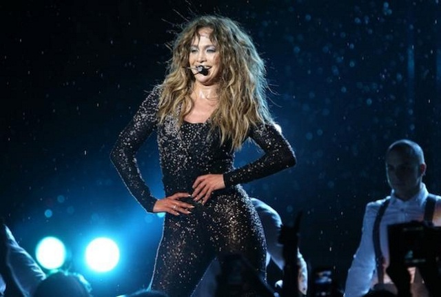 JLo was sporting enough to come out into the rain and perform for us mere mortals