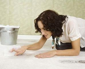 woman cleaning carpet stains