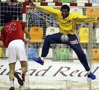 funny picture handballer throws ball against nuts of goalkeeper