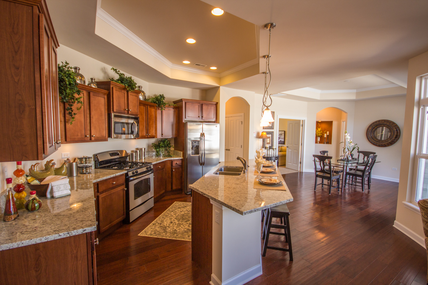 The extravagant gourmet kitchen features a spacious island perfect for entertaining