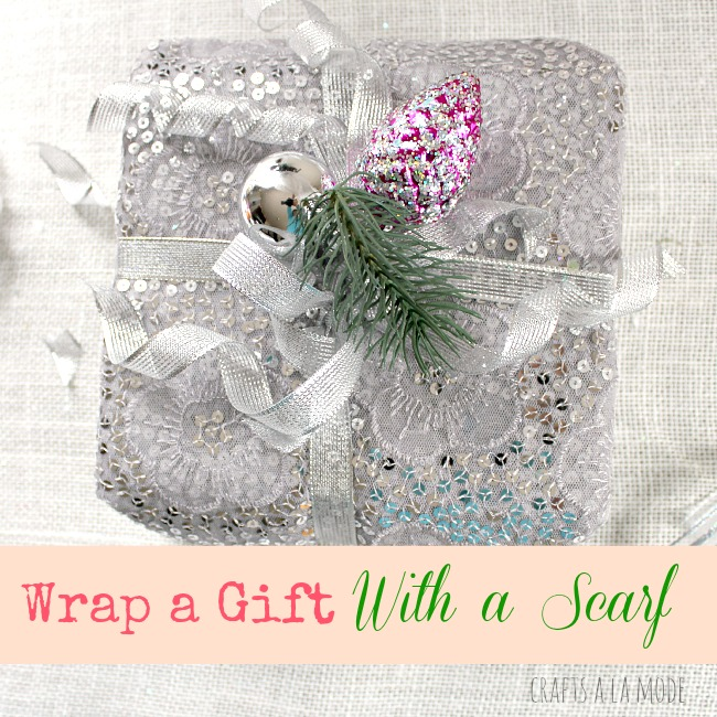 Gift wrapped with a pretty silver scarf