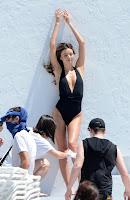 Miranda Kerr in a black swimsuit at Miami beach