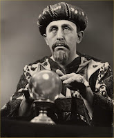 black and white photo of a mystic checking with his chrystal ball
