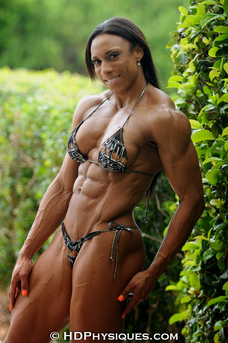 image Ripped female muscle cougar naked in the gym