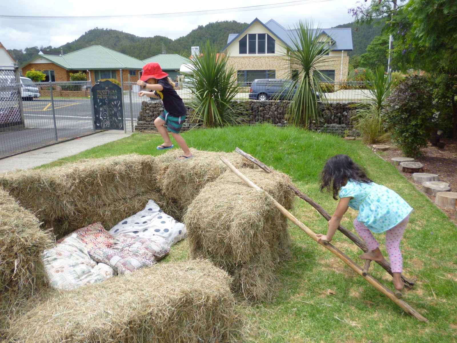 Let the children play simple play space transformations for Hay bail pool