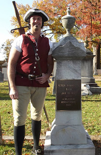 Peter Francisco beside his own grave at Shockoe Hill Cemetery