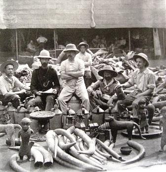 British soldiers of the infamous Punitive Expedition of 1897 proudly posing with  looted Benin artifacts.