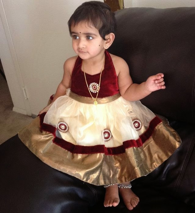 Cute Baby in Maroon Frock