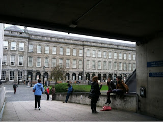 trinity college in Ireland. Students are walking around the campus