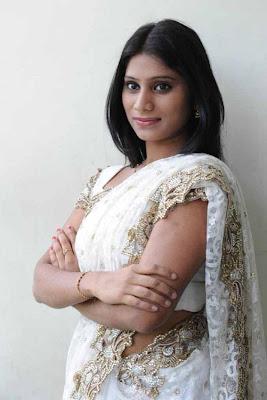 midhuna in saree cute stills