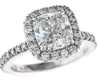 Here a few of the costs of cushion cut diamond engagement rings