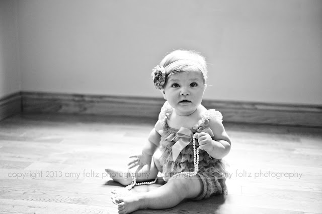 black and white photo of a six month old baby girl