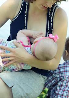 mama breastfeeding in public