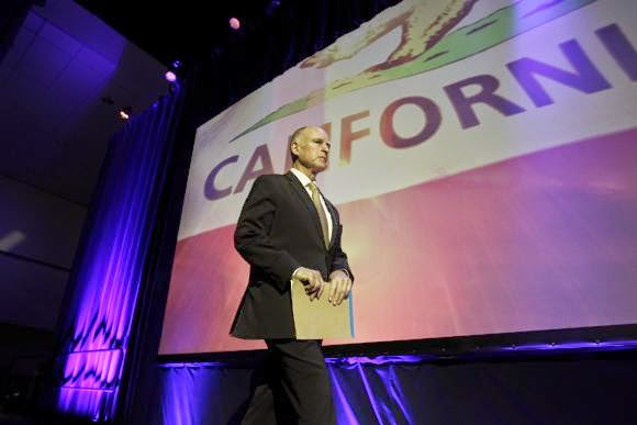 California Governor Jerry Brown walks onstage to speak at the 2014 California Democrats State Convention. (Credit: Reuters/David McNew) Click to enlarge.