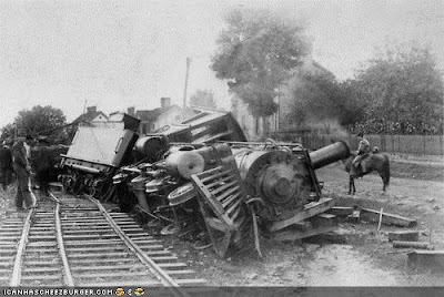 black and white photo of derailed train