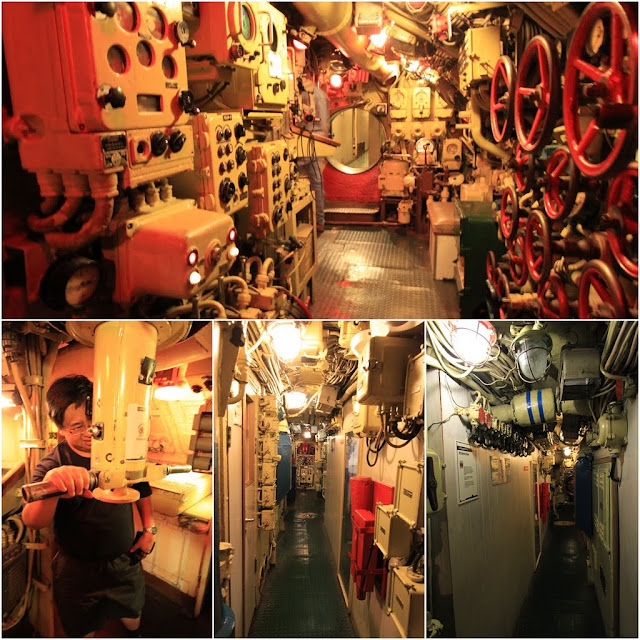 The Main Engine Room with the valve control wheels and Periscope in Russian Scorpion Submarine at Long Beach, Los Angeles, California, USA