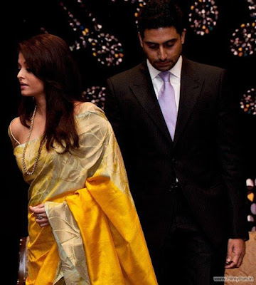 Aishwarya looked fabulous in a mustard coloured sari