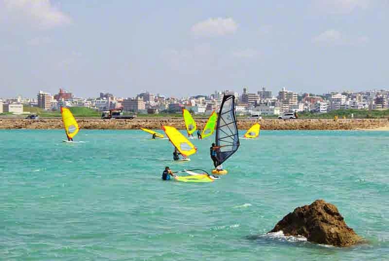 windsurfers, cityscape,ocean