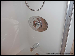 contractor's plate installed on shower control
