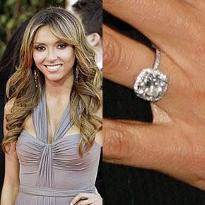 Giuliana Rancic wearing her four carat cushion cut diamond engagement ring.