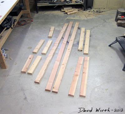 instructions and wood pieces cut out for work bench, 2x4, wood