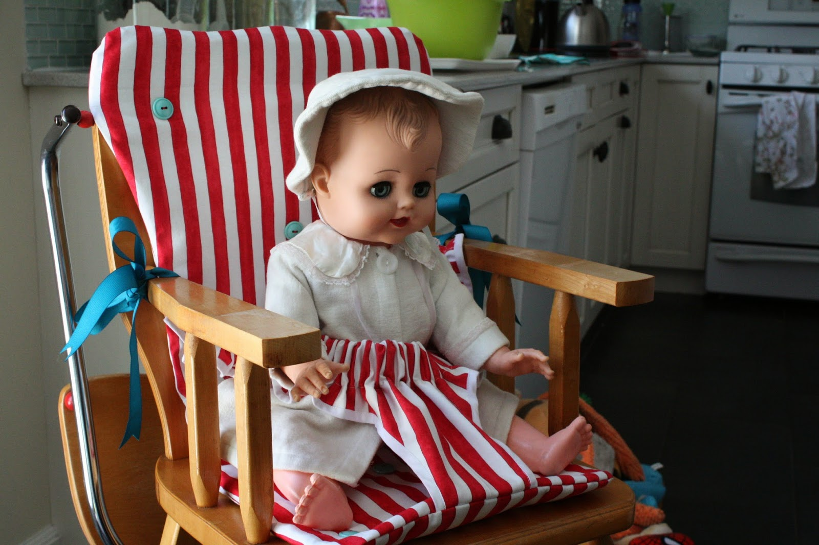 Madly Off In All Directions Hey Baby Busy Bee Round Bib And Ties To The Arms Of Chair With Big Fat Grosgrain Ribbons Teal Please Also Notice Vintage Turquoise Buttons I Used Secure Quilt