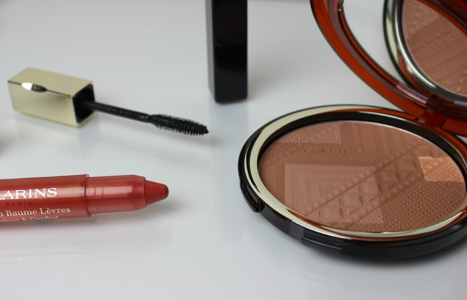A picture of Clarins Colours of Brazil Lip Balm Crayon in 03 Tender Coral