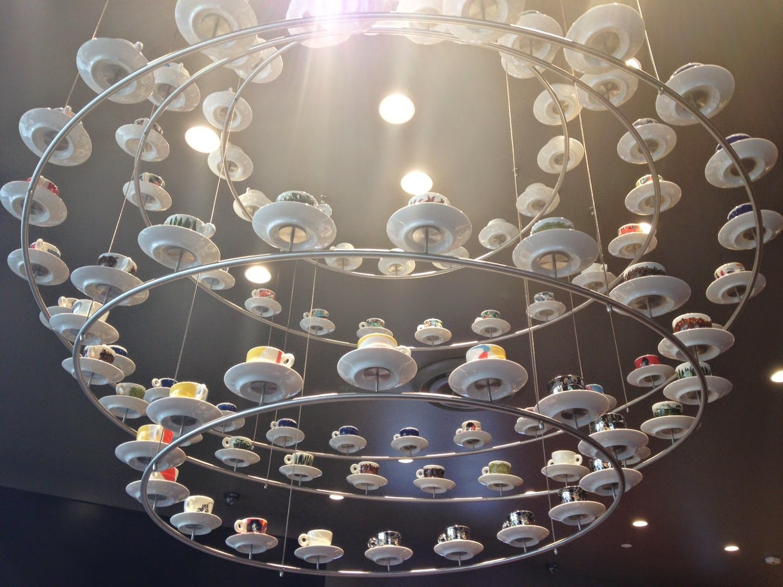 New illy cafe espressamente illy opens in metro theater in san the metro theater location boasts a whimsical chandelier made of 96 illy art collection cups designed by the greatest film directors of our time pedro arubaitofo Choice Image