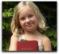 third grader holds her new Bible