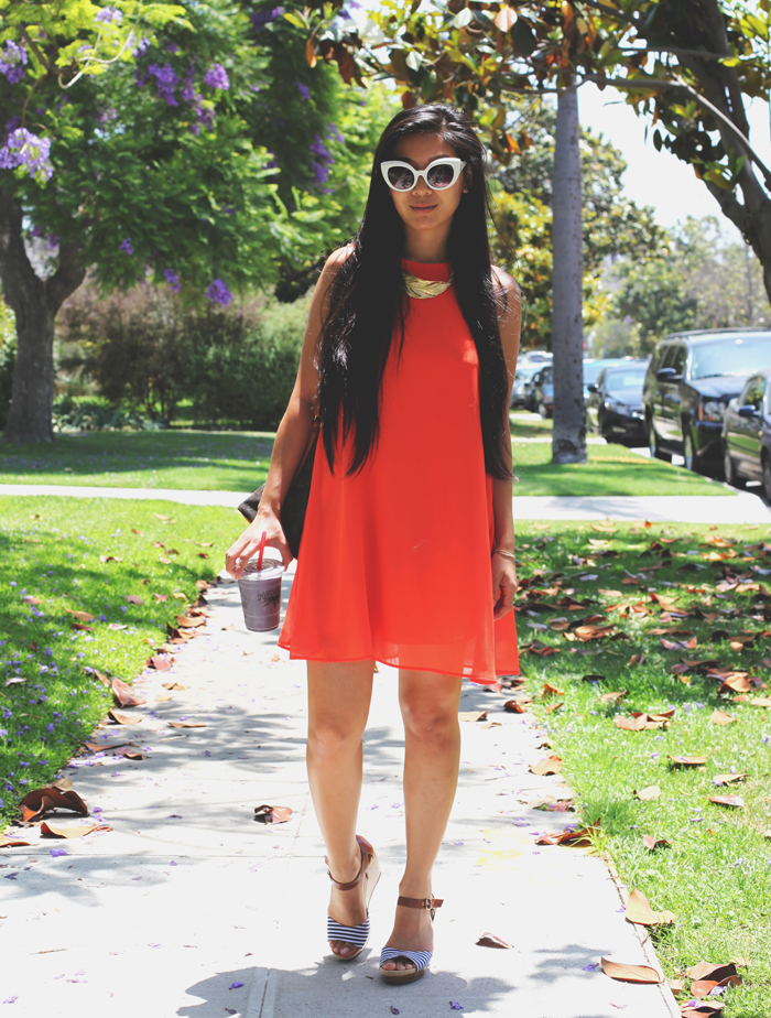 Stephanie Liu of Honey & Silk wearing Lulu*s dress, CRAP The Diamond Brunch sunglasses, Chloe + Isabel feather necklace, Louis Vuitton Noe bag, and Dr. Scholl's Shoes