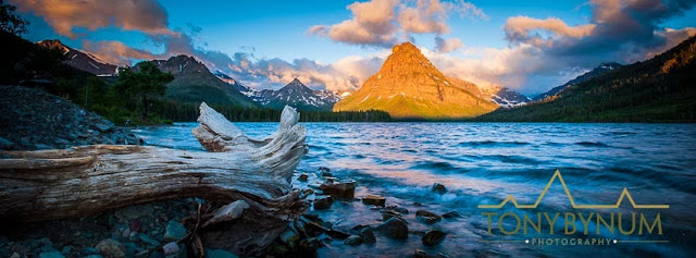 Sunrise on Sinopah Mountain, Waves from Two Medicine Lake crashing on the beach and into a stump, Glacier National Park