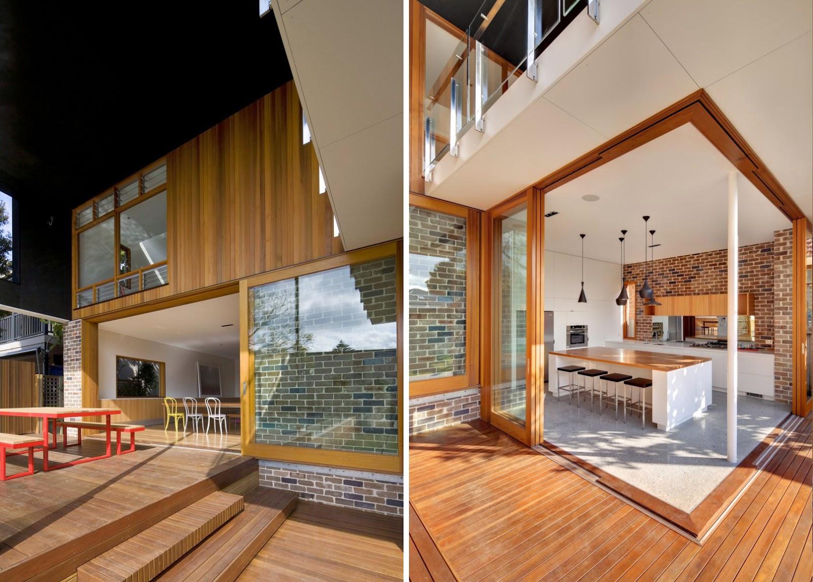 la vivienda localizada en uno de los suburbios cercanos al puerto de castlecrag se abre hacia el interior de la parcela un robusto sistema de puertas