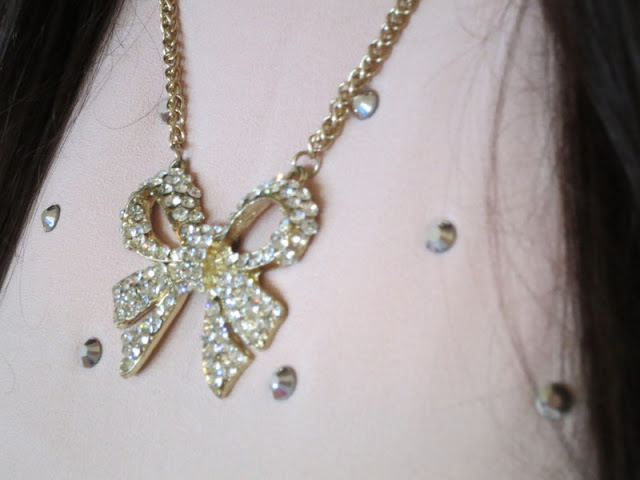 A sparkly bow necklace.