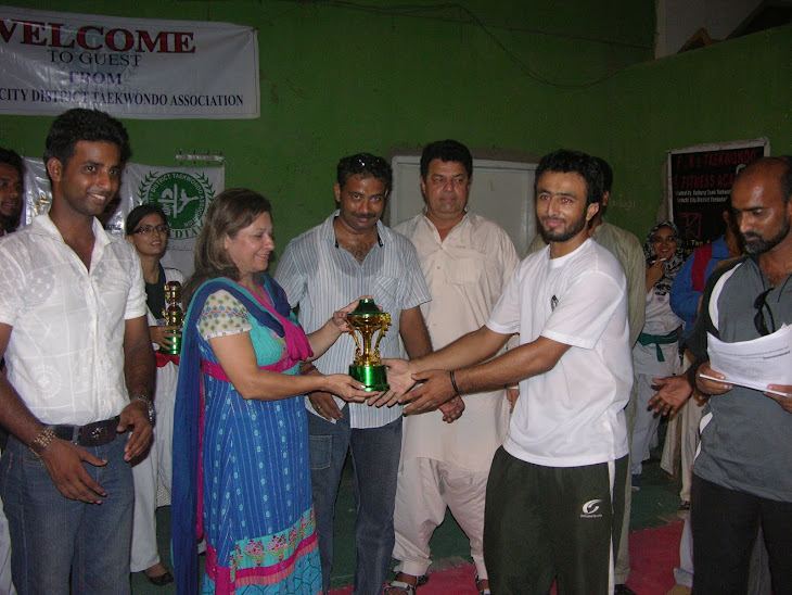 KCDTA Zone 4 Coach rciving 2nd position trophy