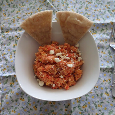 Greek Salsa:  Finely diced tomato, onion, cucumber, bell pepper, feta and garbanzo beans. A Greek salad in salsa form.