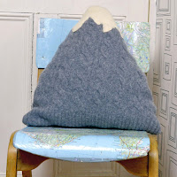 http://www.pillarboxblue.com/upcycled-sweater-mountain-cushion/