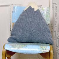 http://www.pillarboxblue.com/upcycled-sweater-mountain-cushion/