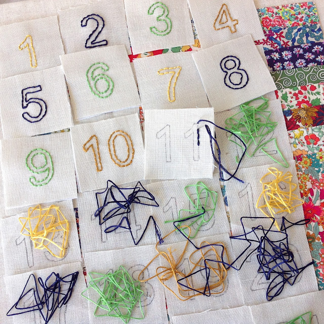 hand-embroidered numbers for the advent calendar pockets