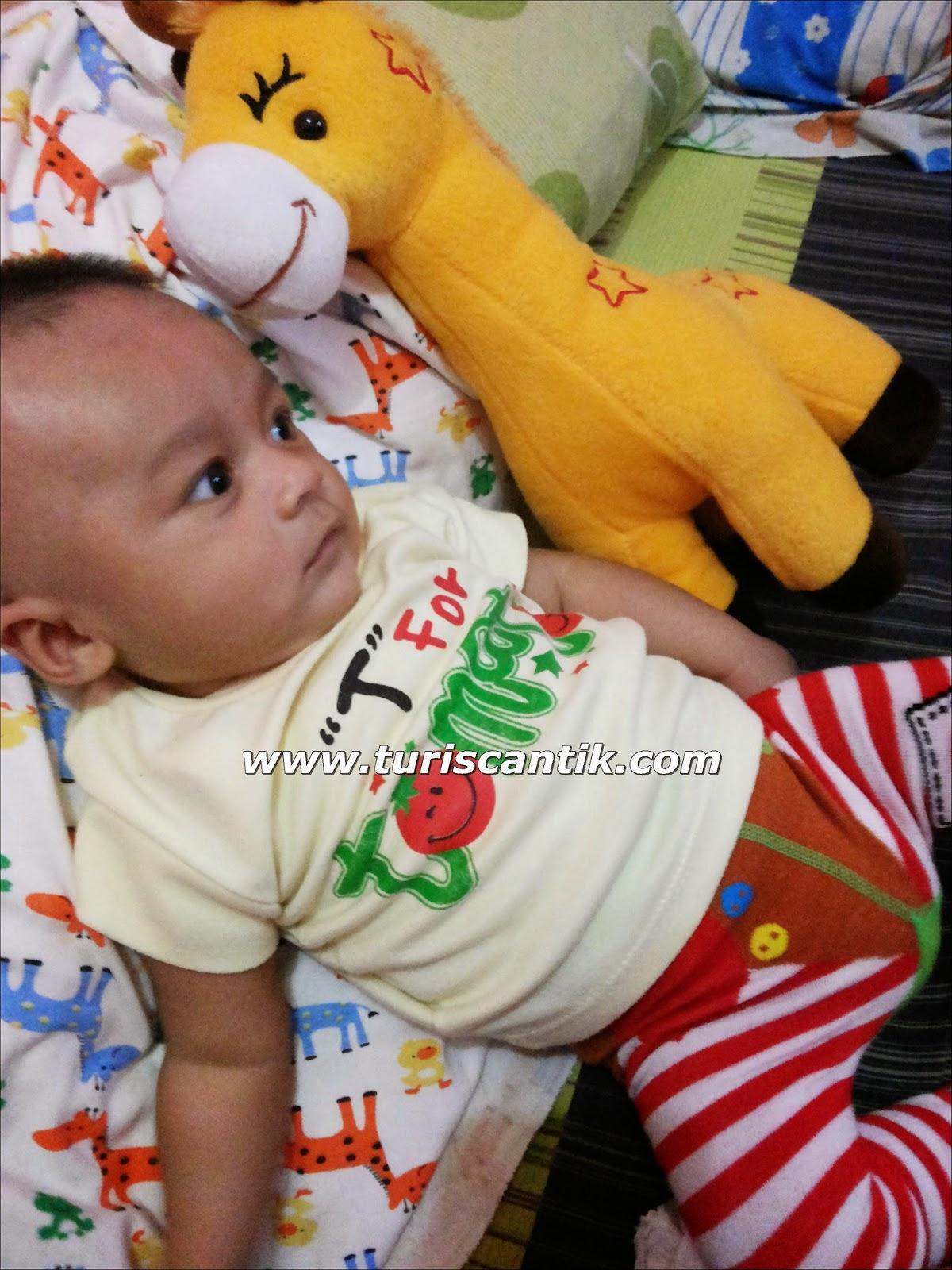 His first play mate Mr Bayam si jerapah