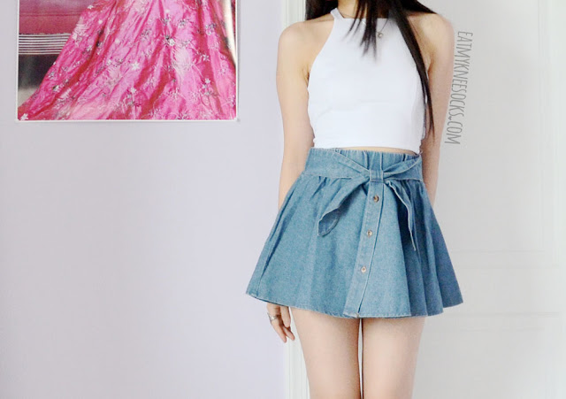 A fun, cute summer or spring ulzzang-inspired outfit, with a white crop top and bow-tie denim skater skirt from Yumart.